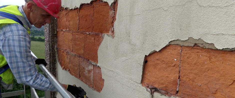 One of our concrete repair specialists working on an external wall